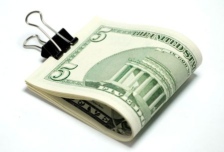 some 5 dollar bills held by a clip Stock Photo - 3478888
