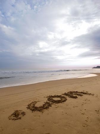 dot com written on the sand