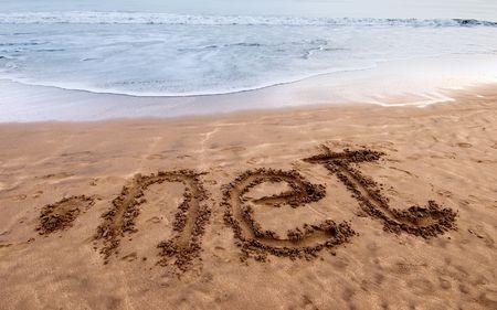 dot net written on sand near the sea
