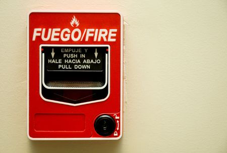 a red fire alarm mounted on a wall Stock Photo