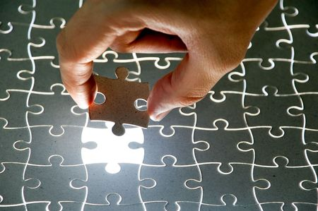 holding a puzzle piece photo