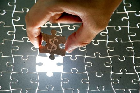 holding a puzzle piece Stock Photo - 3478975