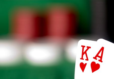 suited up: suited king and ace with poker chips in the background Stock Photo
