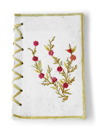 recycled paper note pad over a white background