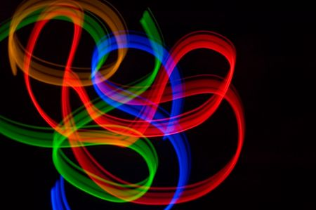 some colrful LED lights in motion resembling ribbons photo