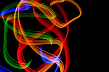 some colorful LED lights in motion resembling ribbons photo