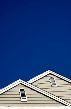suburbian: full moon over some suburbian wodden roofs Stock Photo