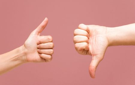 thumb up and down Stock Photo