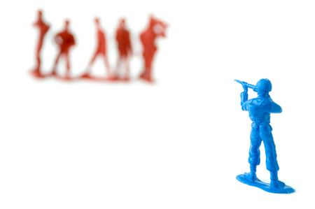 some toy soldiers aiming at each other photo