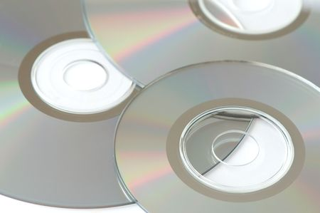 arrangement of three cds over white background Stock Photo