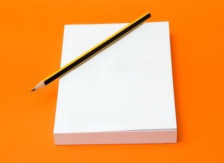 blank book and pencil over an orange background Stock Photo - 3595837