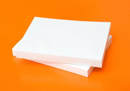two blank books over an orange background Stock Photo - 3595838