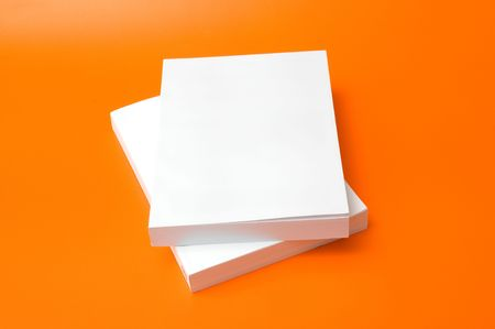 two blank books over an orange background Stock Photo - 3595839