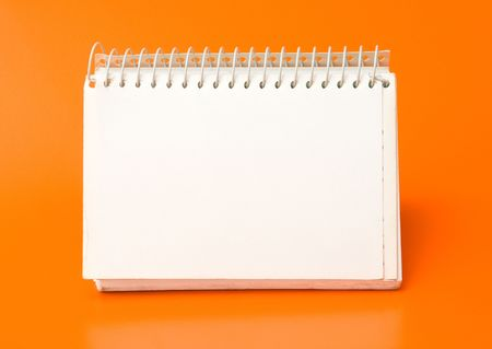 blank spiral calendar over an orange background Stock fotó
