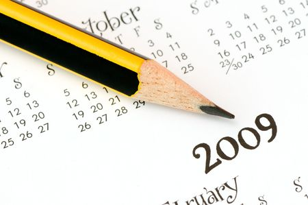 pencil over a 2009 calendar pointing at the year