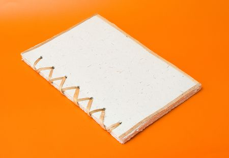recycled notepad over an orange background Stock Photo - 3595859