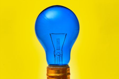 blue light bulb isolated over yellow background