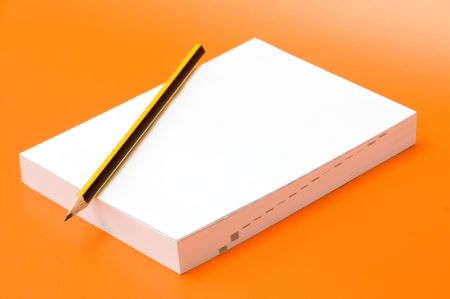 blank book and pencil over an orange background Stock Photo - 3680953