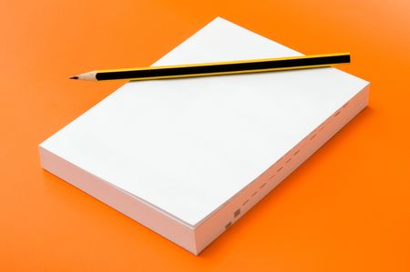 blank book and pencil over an orange background Stock Photo - 3680944