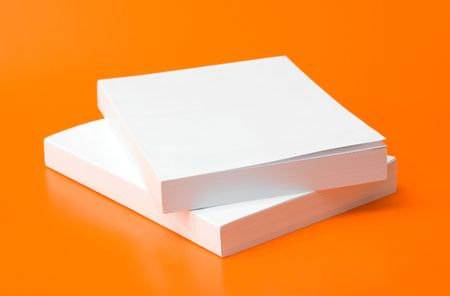 two blank books over an orange background Stock Photo - 3680947