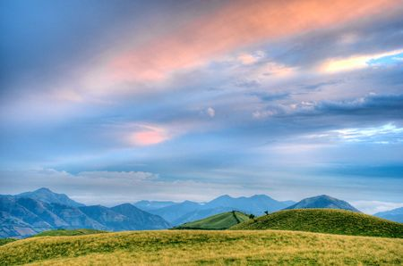 hdr background: beautiful hdr landscape with mountains and cloudscape