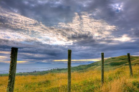 beautiful hdr scene of a fence and cloudscape photo