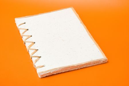 recycled notepad over an orange background Stock Photo - 3680957