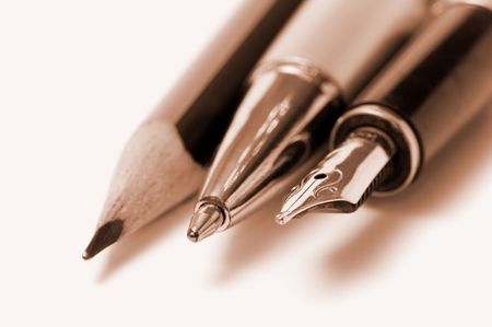 pencil, pen and fountain pen isolated over white Stock Photo