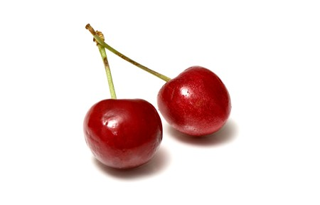 beautiful cherries isolated over a white background photo