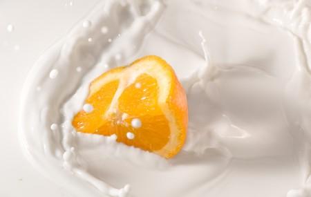 beautiful orange splash in a milk bowl Stock fotó