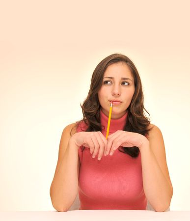 Beautiful woman in red top with a pencil Stock Photo - 7889951