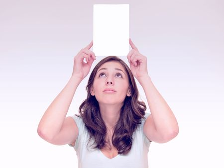 Beautiful young woman holding a blank card Stock Photo - 7889950