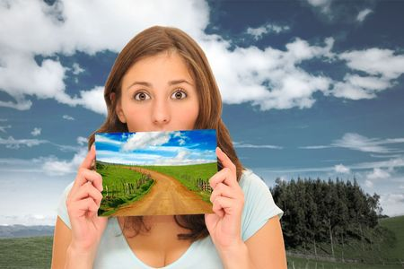 Beautiuful woman holding a perfect meadow road picture Stock Photo - 8101816