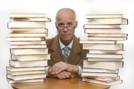 Mature man surounded by books against a white background photo