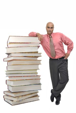 bibliomania: Stack of books with man isolated in white Stock Photo