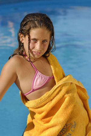 Beautiful girl with green eyes, posing in a pool Stock Photo - 4095339