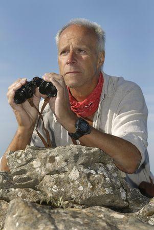 admiring: Explorer with is binocular looking for adventure Stock Photo