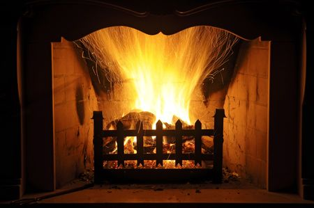 Fireplace with flames burning high Stock Photo - 4139541