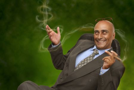 devilish: Devilish businessman in green background Stock Photo