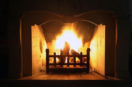 beautiful fireplace burning wood photo