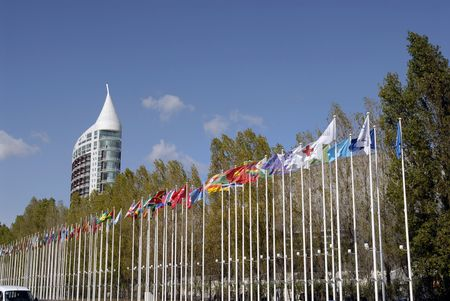 hight tech: Big modern building and flags in Lisbon nations park Stock Photo