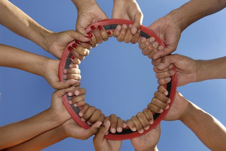 friendship circle: Several hands holding together Stock Photo
