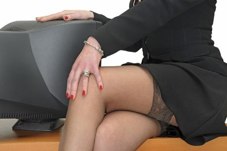 legs stockings: Business woman legs with monitor isolated in white