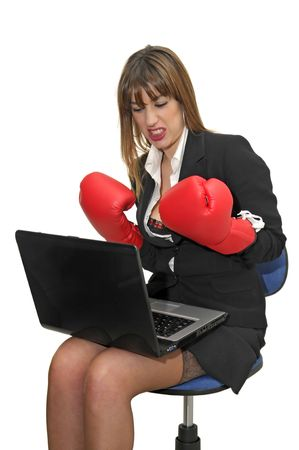 Business woman with laptop and boxing gloves isolated in white photo