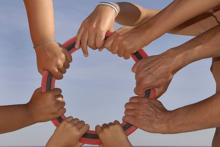 Several hands holding a circle Stock Photo - 4437302