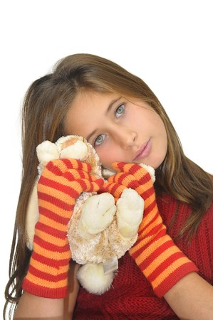 Beautiful young girl posing with gloves and bunny against a white background photo