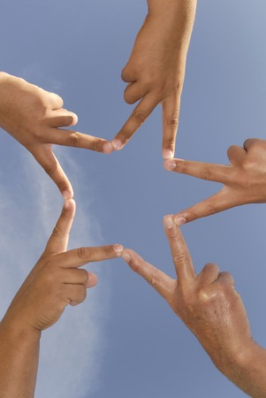 Hands together forming a star Stock Photo - 4492476