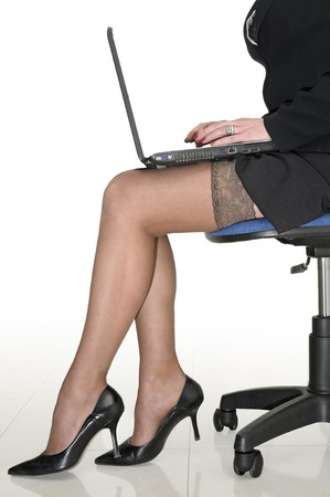 sexy businesswoman: Business woman with laptop isolated in white Stock Photo