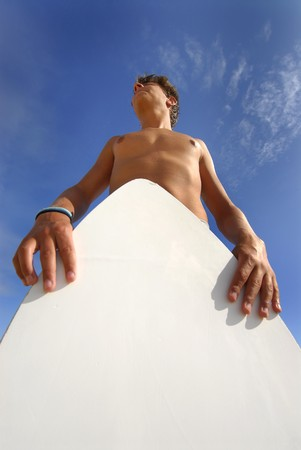 bald head island: Boy with is skimboard against the sky Stock Photo