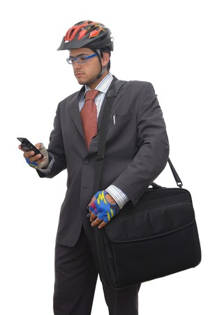 bycicle: Young bycicle rider in suit with cellphone and laptop, against a white background Stock Photo